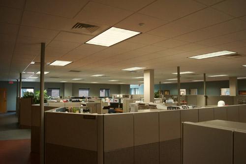 Dimly lit office space with fluorescent lighting prior to using Straits LED lighting fixtures
