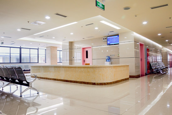Brightly illuminated hospital waiting room area with high quality lighting