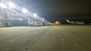 An airport apron being lit with LED Floodlights