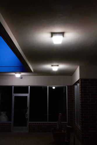 LED Canopy light mounted on the ceiling of a canopy illuminating the area underneath