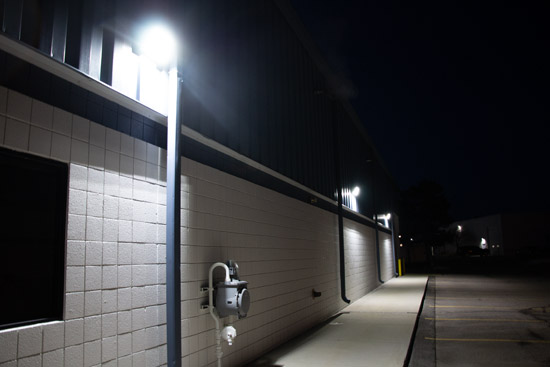 LED Wall Packs on the side of a building illuminating the parking lot