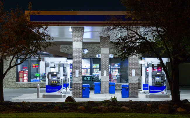 LED lights illuminate a large area under the canopy of a gas station