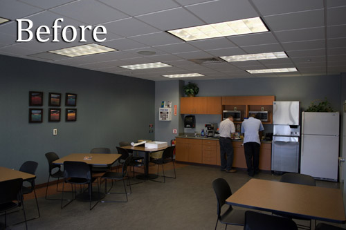 Dimly lit office break room with fluorescent lights before switching to Straits Tri Line T8 LED Troffer Lights